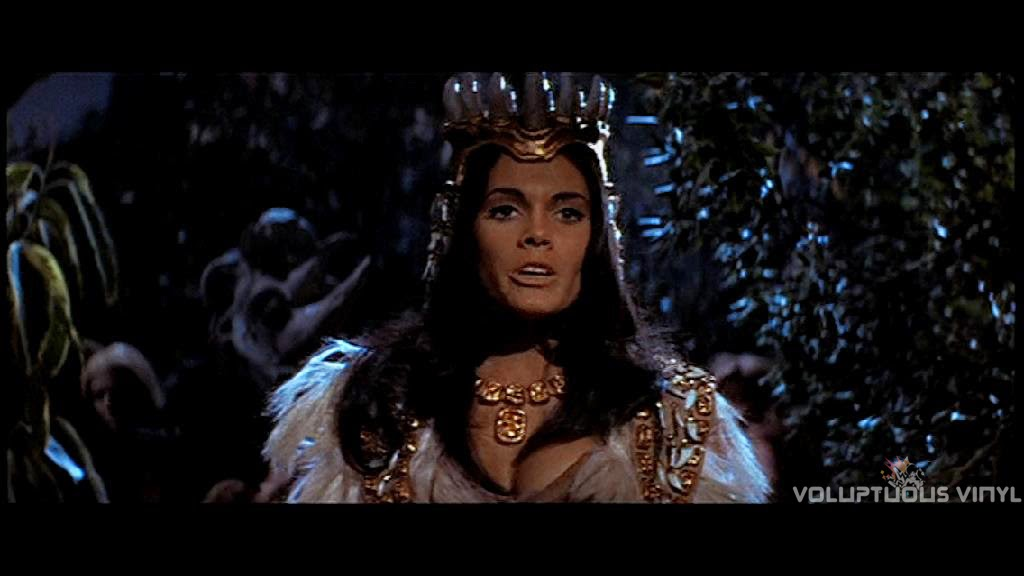 Martine Beswick starring down a charging white rhino in Prehistoric Women