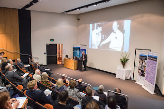 Photo: Prof Nip Thomson describing the opening of a new facility by Kit Fairley and his daughter. Prof Kit Fairly is Professor of Public Health and Director of the Melbourne Sexual Health Centre http://www.med.monash.edu.au/cecs/events/2015-tr-symposium.html