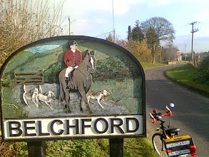 Photo: The west end sign for the Wolds village featuring a huntsman on horseback with dogs.