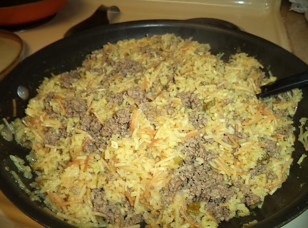 When the rice is done, add the hamburger to the rice a roni and...