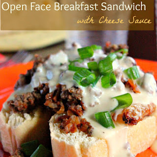 Open Face Breakfast Sandwich with Cheese Sauce.