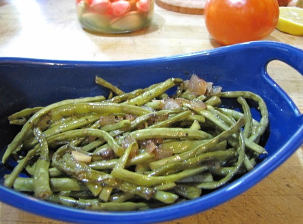The green beans are done when they are tender.  Top with dots of...