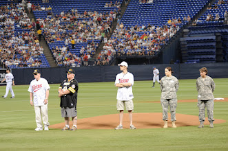 "Photo: The Minnesota Twins host the 7th Annual Armed Services Appreciation Day on July 5, 2009 at the Metrodome in Minneapolis, Minnesota. The pregame festivities included Freedom Flight and Liberty Belle hot air balloons, a performance by the United States Air Force Heartland of America Band ""Night Wing"" and ceremonial first pitches by veterans from conflicts dating back to World War II. During the game the Twins wore caps honoring the five branches of the Armed Services. All current and former members of the Armed Services and their families received four complimentary tickets to the game.