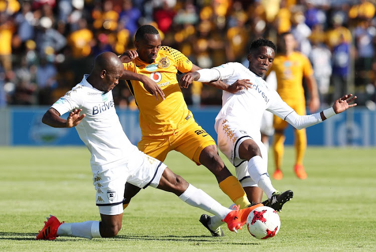 Bernard Parker of Kaizer Chiefs challenged Tebogo Moerane (r) and Phumlani Ntshangase of Bidvest Wits during 2017 Telkom Knockout semifinal match between Bidvest Wits and Kaizer Chiefs at Bidvest Stadium, Johannesburg South Africa on 18 November 2017.