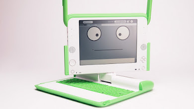 Photo: The XO-Laptop with one of kids most popular first probrams: the Speak application.  The chatbot speaks back what the kids are saying into the XO's microphone.  The moving pupils of the eyes really capture kids imagination.  Many moments of great fun with your kid!