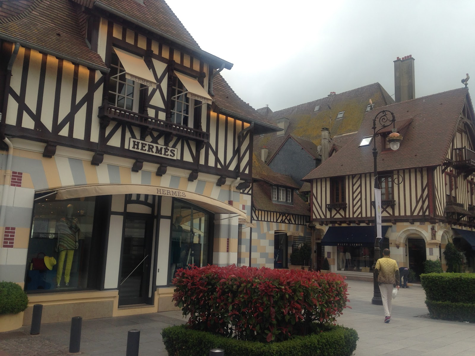 hermes luxury boutique in Deauville. Upscale store located in an authentic medieval building, surrounded by other traditional structures on a cloudy day in france.