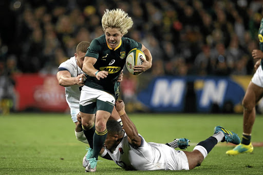 Buzzsaw: Faf de Klerk snipes his way through the England defence at Ellis Park on Saturday. Picture: APF