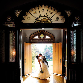 Bride & Groom's Entrance by Jennifer Newberry - Wedding Bride & Groom ( kiss, backlit, married, dip, backlight, wedding, sweetheart kiss, castle, bride and groom, whitby ontario )