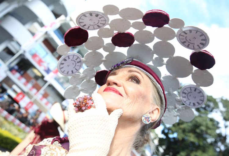 Never to old to rock that clock: Win Wheeler wearing a hat by her husband Mike at the Durban July.
