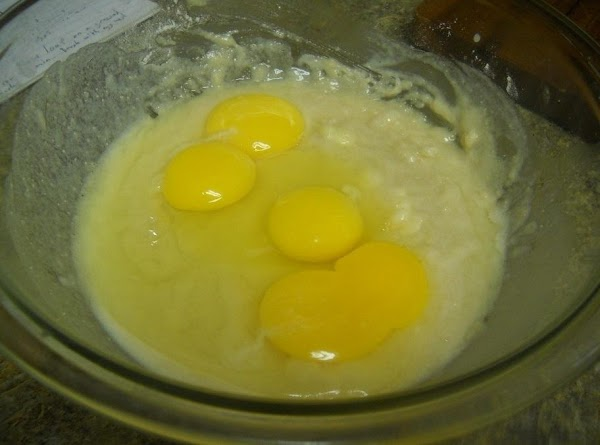 Add remaining flour, eggs and egg yolks to mixing bowl. Combine with hands, mixing...