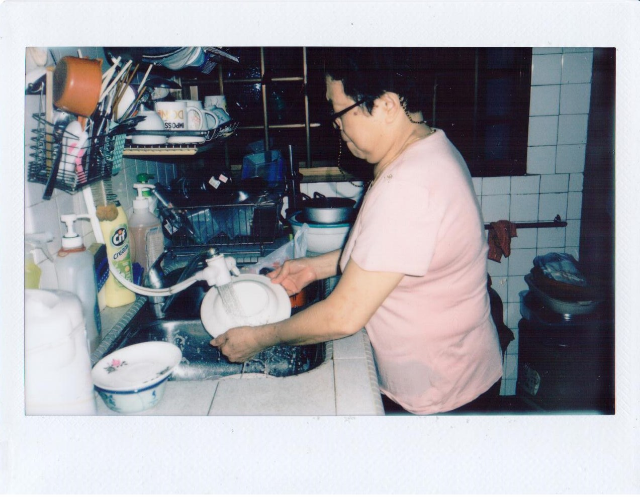 My Mother washing dishes