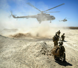 Photo:  Members of the National Interdiction Unit (NIU) and Special Operations Task Group (SOTG) await the arrival of two Mi17 helicopters. Mid caption: Australian Special Forces have partnered with the Afghan National Interdiction Unit (NIU) to combat the drug networks that fund insurgent activities. Members of the Special Operations Task Group (SOTG) commenced operations with the NIU in May to help sever the link between the insurgency and the narcotics trade. NIU operations reduce the Afghan narcotics trade and the threat it poses to the long term security, development and governance of Afghanistan. Combined effort has resulted in hundreds of kilograms of drugs destroyed or confiscated as evidence and several individuals detained to face prosecution.Deep: The Special Operations Task Group is deployed to southern Afghanistan to conduct population-centric, security and counter network operations. SOTG support the Afghan National Police's Provincial Response Company in Uruzgan and northern Kandahar. SOTG includes members from the Special Air Service Regiment (SASR), 1st and 2nd Commando Regiments, the Incident Response Regiment, Special Operations Logistic Squadron and supporting units.      Photo By CPL Christopher Dickson1st Joint Public Affairs Unit.