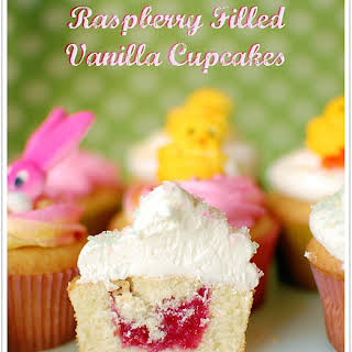 Raspberry Filled Vanilla Cupcakes with Butter Cream Frosting.