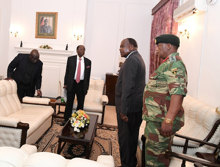 Zimbabwe's President Robert Mugabe meets with Father Fidelis Mukonori, Secretary to the Cabinet Dr Misheck Sibanda and Defence Forces Commander General Constantino Chiwenga at State House in Harare, Zimbabwe,  November 19, 2017.