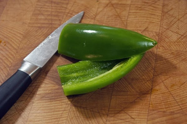 Slice the jalapeño in half, and remove the seeds.