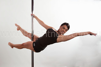 Photo: Vertical Pole Gymnastics - One Handed Scissor Layout