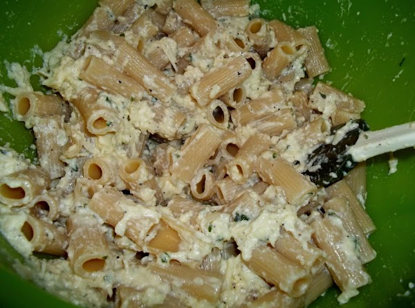 Pour the cooked and drained rigatoni into the cheese mixture, toss well.Preheat oven to...