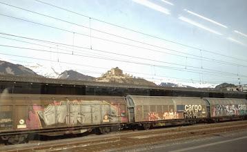 Photo: Castle overlooking graffiti strewn rail cars