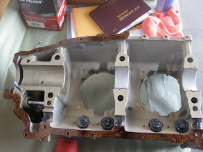 Photo: Aviation Form-a-Gasket painted on thinly to the case half.  Silk thread not yet fitted.  DO NOT put gasket seal on the center portions, and do not put silk thread there either.  Note tappets and camshaft bearing surface coated with moly assembly lube.