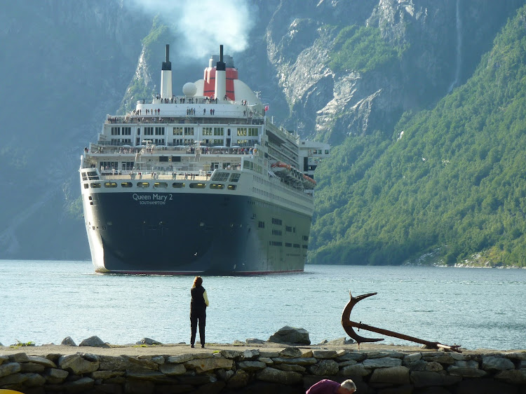 Queen Mary 2 navigates a fjord in Norway.