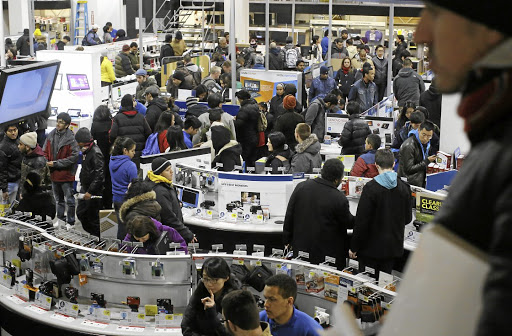 Customers hunt for bargains at a Best Buy store in the US on a Black Friday. REUTERS