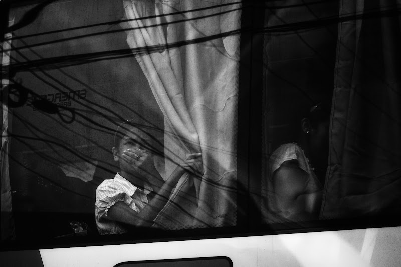 """Photo: """"Some things just make me wonder...""""  ...like for how long a regular commuter's body can take the toll of air and noise pollution before it finally caves in.  ...like why the girl inside this air-conditioned bus is covering her nose.  ."""