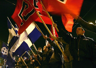 Photo: Greek Neo-nazis gather in central Athens 27 January 2007, to commemorate the killed Greek officers in the Greek-Turkish  incident in Imia (Kardak) island in January 1996. Some 300 ultra-nationalist and neo-nazis from Greece supported by a group from Germany  shouted nationalist and anti-Turkish slogans .AFP PHOTO/Louisa Gouliamaki (Photo credit should read LOUISA GOULIAMAKI/AFP/Getty Images)