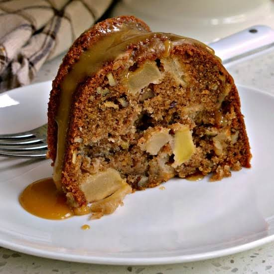 A Scrumptiously Moist Apple Cake With Chunks Of Fresh Apples And Pecans All Topped With An Easy Four Ingredient Caramel Drizzle.