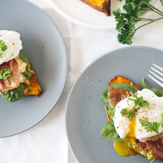 """Sweet Potato """"Toast"""" with Avocado, Spinach, Prosciutto and Poached Egg."""