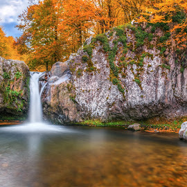 Gyumberdzhiyata waterfall by Petar Shipchanov - Landscapes Waterscapes ( sky, forest, bulgaria, pool, clouds, long exposure, leaf, water, stone, rock, orange, mountain, rocks, leaves, waterfall, rhodopes, stones, river, autumn )