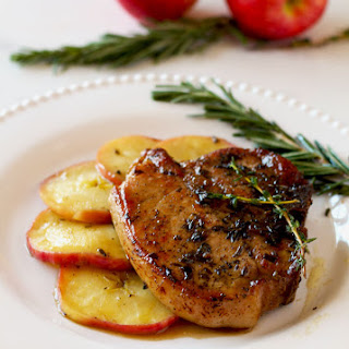 Herb Crusted Pork Chops with Apple and Maple Bourbon Glaze.