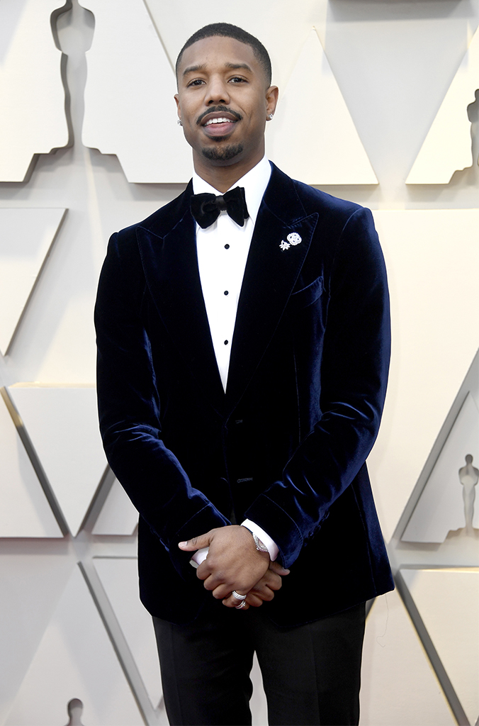 Piaget ambassador Michael B Jordan at the 91st Academy Awards wearing full paved diamond white-gold Possession rings, two Limelight Couture Précieuse brooches and a Piaget Polo Tourbillion.