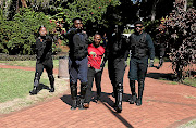 One of the four arrested students at DUT is led away yesterday./Sandile Ndlovu
