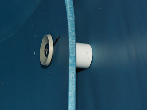 """Photo: Detail of spacer to keep the false wall away from the back wall.  It is a 1 inch long piece of the 1/2"""" PVC pipe."""