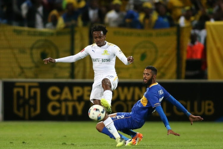 Percy Tau of Mamelodi Sundowns gets past Taariq Fielies of Cape Town City FC during the Absa Premiership match between Cape Town City FC and Mamelodi Sundowns at Athlone Stadium on February 02, 2018 in Cape Town, South Africa.