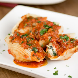 Shrimp and Goat Cheese Stuffed Shells with Roasted Red Pepper Sauce.