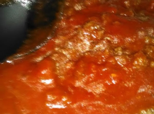 In a skillet, brown the ground beef until cooked through; drain fat and stir...