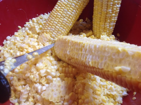 Using a sharp knife cut the corn down the length  of each ear...