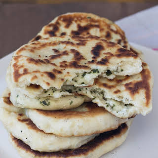Homemade Cheese & Herb Stuffed Naan.