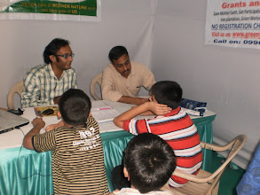Photo: Dr. Pradeep busy to explaining about GGK to kids and their parents