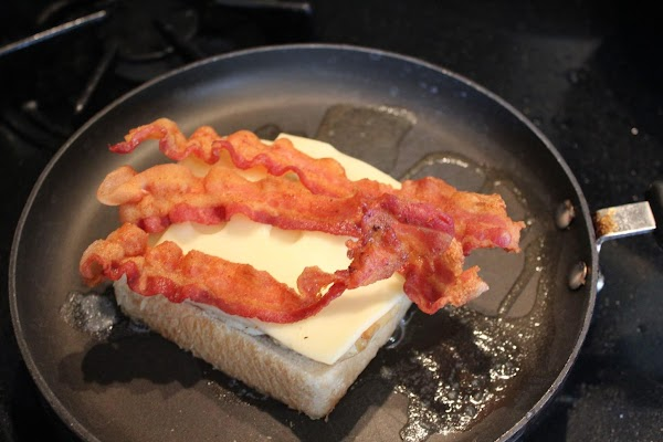 Next, add the 2 Swiss cheese and 3 pieces crisp bacon.