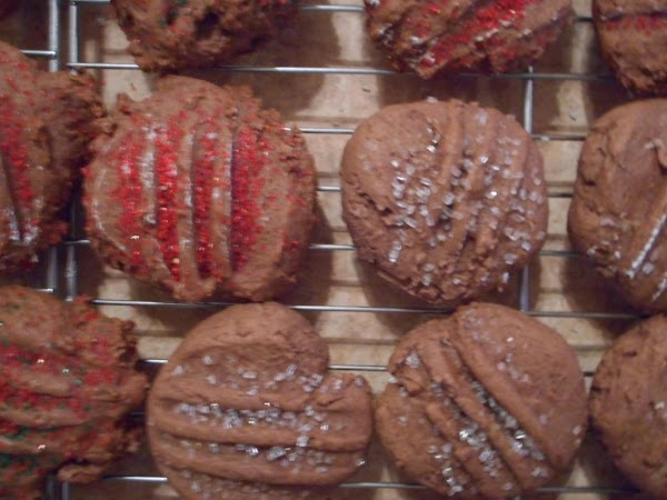 Drop by heaping teaspoonfuls onto prepared cookie sheet.  Flatten slightly with fork dipped...