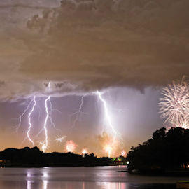 Stormy fourth by Eric Ebling - Landscapes Weather ( lightning, sky, storm, night, weather, clouds, fourthofjuly, fireworks, lake )
