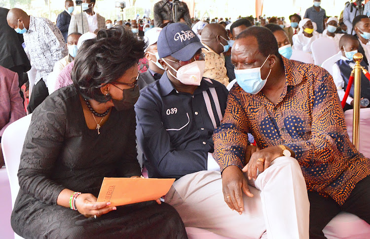 Youth and Gender CAS Rachael Shebesh, Bungoma Governor Wycliffe Wangamati and Kakamega Governor Wycliffe Oparanya during the funeral of Florence Sakwa in Kakamega.