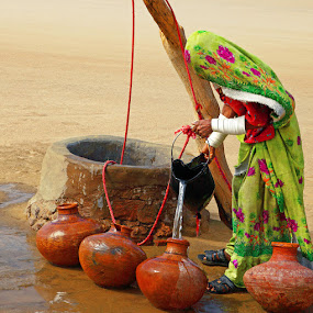Thar Well by Sami Ur Rahman - People Street & Candids ( desert well, thari woman, water pitchers, colorful dress, thar desert )