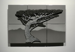 """Photo: """"Acacia Tree"""" This piece is based on a drawing of an acacia tree that my son, David, sent me while serving in the Peace Corps in Kenya. Mount Kilimanjaro is on the horizon on the left. The clay body used in the previous work is used here again with a crackle glaze on the trunk, gray glaze in the background, and India ink everywhere else."""