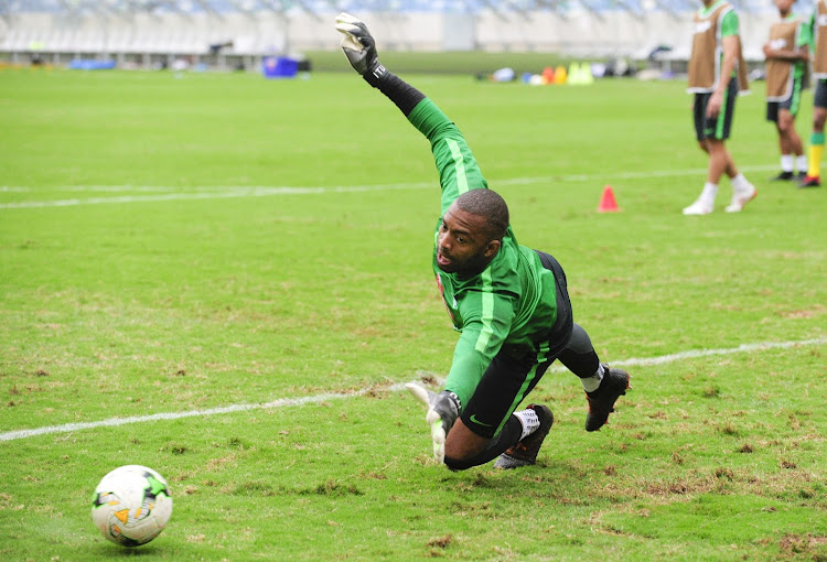 Bafana Bafana and Kaizer Chiefs goalkeeper and captain Itumeleng Khune dives for the save during the SA training session at Moses Mabhida Stadium in Durban on September 6 2018.
