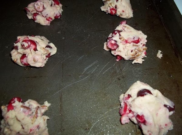 Drop by tablespoonfuls 2 in. apart onto greased baking sheets. ( my cranberries were...