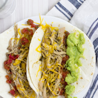 Easy and Healthy Crockpot Salsa Verde Shredded Pork Tacos.