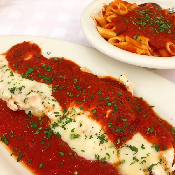 Chicken Parmesan and gf pasta with tomato sauce.